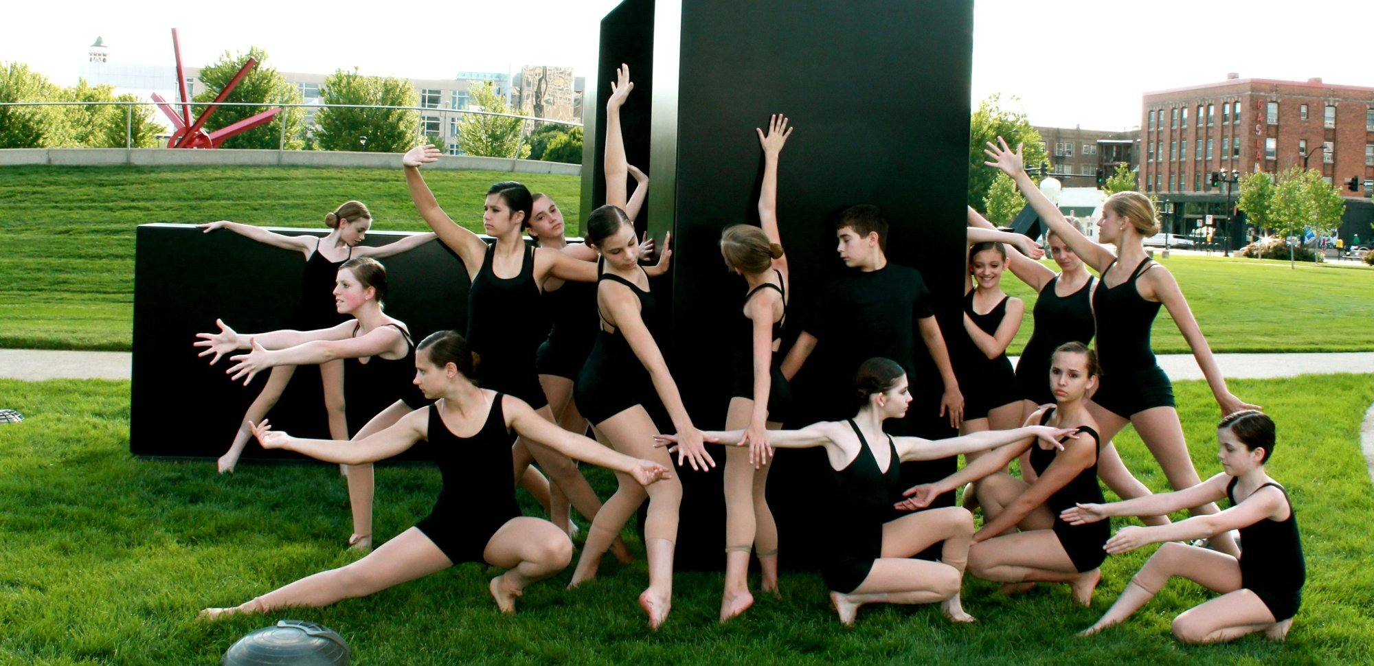 Brekke Dance Center students posing by a sculpture