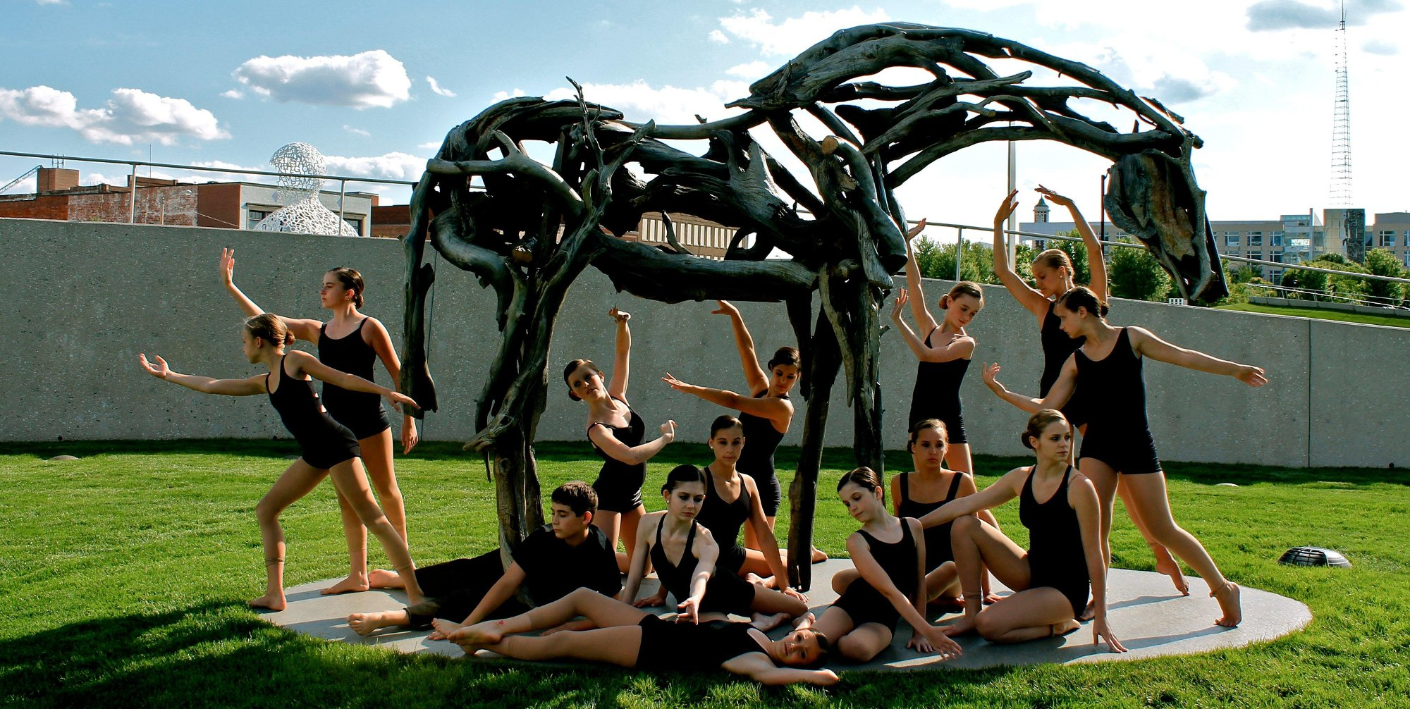 Brekke Dance Center posing at a horse sculpture in Des Moines